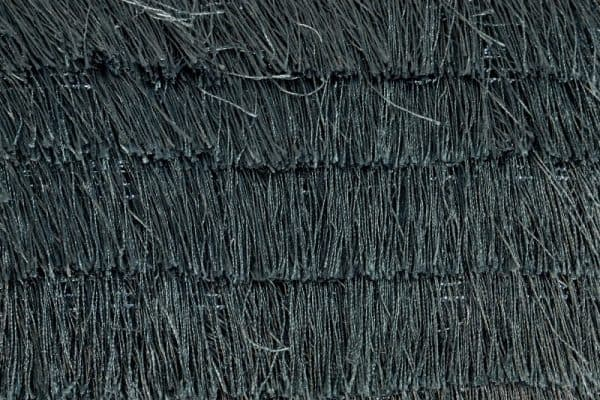Tmavozelený vankúšik so strapcami »