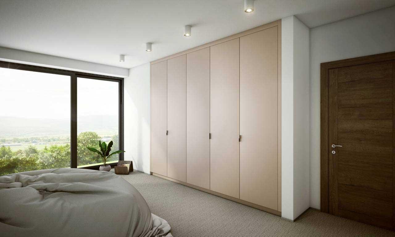 Vstavané skrine ponúkajú dostatok úložného priestoru, čo si vaša útulná spálňa rozhodne zaslúži. Zdroj: iKuchyne.sk
